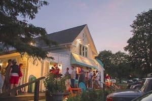 Photo of the white cottage Ice Cream Cafe at dusk.