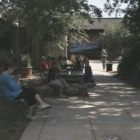 PHOTO OF SEVERAL CLASS PARTICIPANTS RELAXING OUTSIDE THE INSTITUTE.