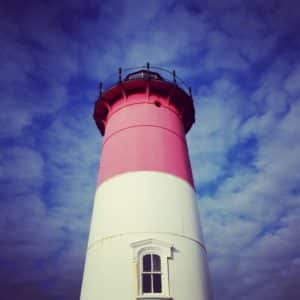 The top of the red/white Nausett Lighthouse