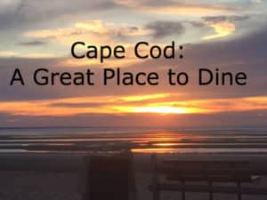 Sunset over the ocean with title: Cape Cod, A Great Place to Dine.