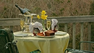 A table setting at the Inn with a vase of daffodils in the center.