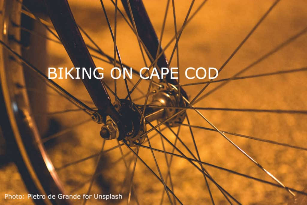 The spokes of a bike shot in a soft golden light.