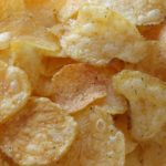Close up photo of golden fried potato chips