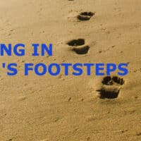 Photo of footsteps in the sand.