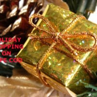 "Gold foil-wrapped gift box with title, ""Holiday shopping on Cape Cod."""