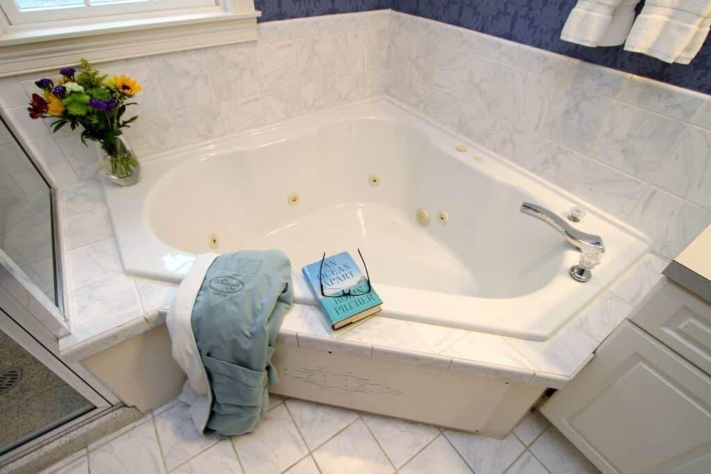 Spa tub with towel laying on the edge.