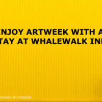YELLOW BACKGROUND WITH WOMAN WALKING THROUGH IT AND TITLE: ENJOY ARTWEEK WITH A STAY AT WHALEWALK INN